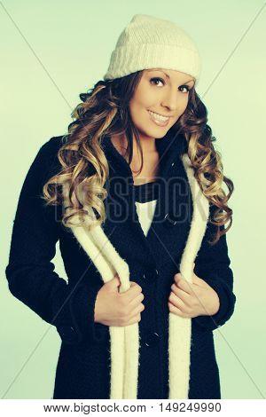 Pretty winter fashion woman wearing scarf and beanie