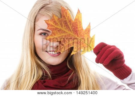 Happy Smiling Girl In Gloves Holding Autumnal Leaf
