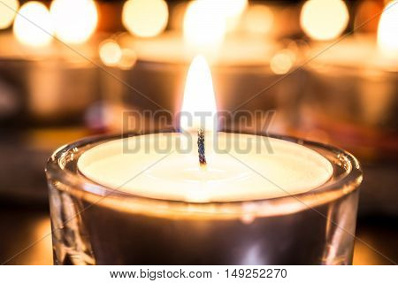 Relaxing Tealight With A Bokeh Of Several Candles