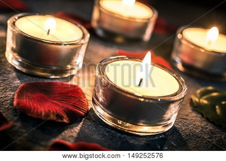 4 Romantic Candlelights On Slate With Rose Petals And Leafs