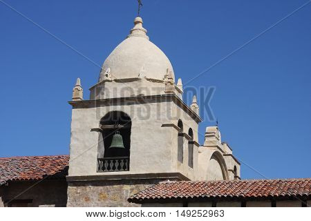This is an image of the Carmel Mission taken on a sunny day in Carmel, California.