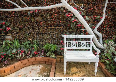 Wood lawn chair in a beautiful garden.