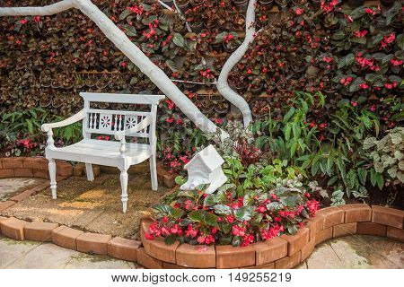 Wood lawn chair in a beautiful garden.