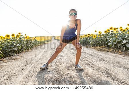 Beautiful Young Woman Stretching And Preparing For Running In Countryside.