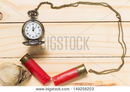 Human Skulls, Red Shotgun Shell, Antique Clock