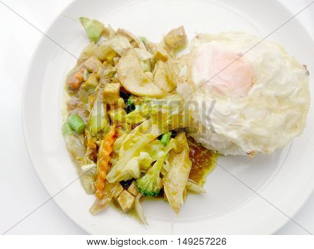 Stir-fried Curry Powder With Mixed Vegetables. Phat Phong Kari In White Plate On White Background. V