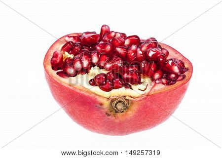 Half fruit of red pomegranate isolated on white background close up.