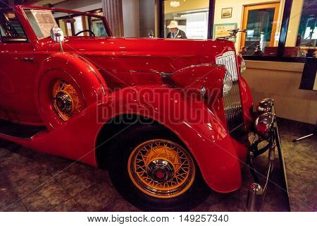 El Segundo, CA, USA - September 26, 2016: Red 1936 Packard Roadster Car displayed at the Automobile Driving Museum in El Segundo, California, United States. Editorial use only.