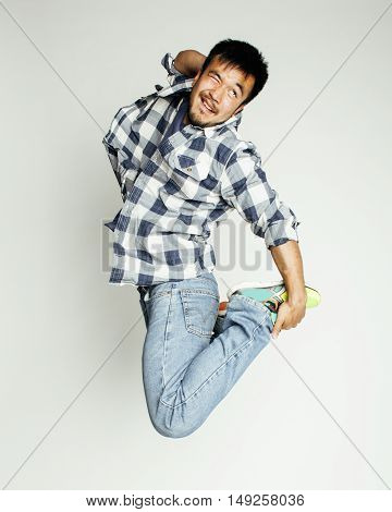 young pretty asian man jumping cheerful against white background, lifestyle people concept close up