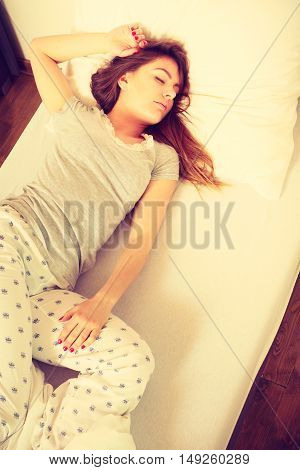 Relax night morning rest concept. Girl drowning in dreams. Young lady lying in bed covered by blanket dreaming deeply.
