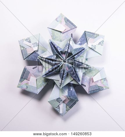 snowflake origami made of banknotes rubles. Handmade