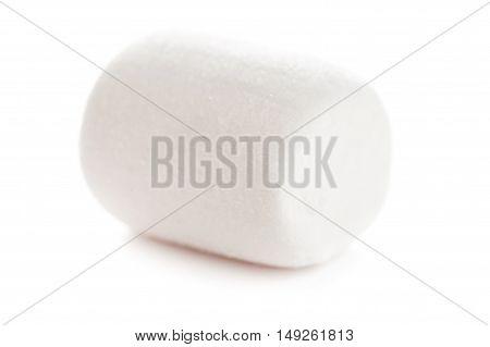 Single Fluffy white marshmallow macro isolated over white background.