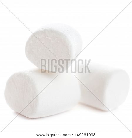 Fluffy white marshmallow macro isolated over white background. Heap of white marshmallows