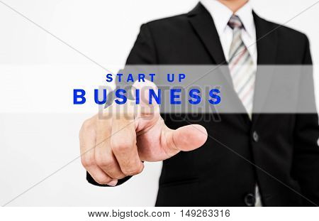 Businessman pressing start up BUSINESS button on screen display, concept of start new business or forward thinking