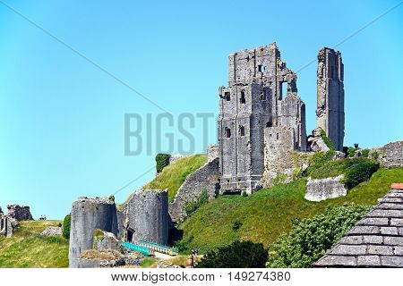 CORFE, UNITED KINGDOM - JULY 19, 2016 - View of Corfe castle on the hilltop Corfe Dorset England UK Western Europe, July 19, 2016.