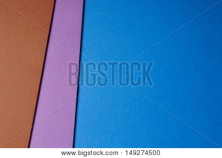 Colored cardboards background blue purple brown tone. Copy space. Horizontal