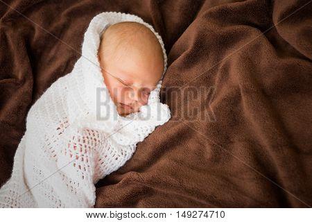 Newborn baby  girl sleeping in white blanket