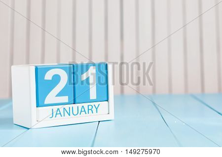 January 21st. Day 21 of month, calendar on wooden background. Winter time. Empty space for text.