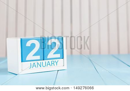 January 22nd. Day 22 of month, calendar on wooden background. Winter concept. Empty space for text.