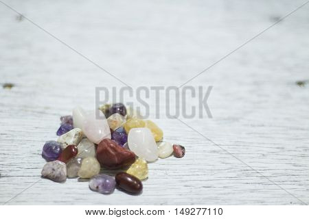 Gemstones on a antique painted wood board