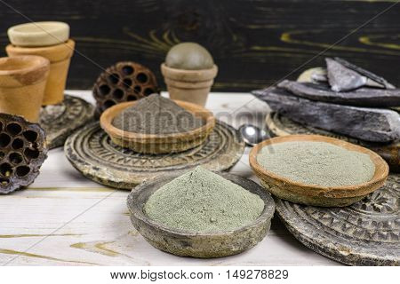Ancient minerals - black green blue clay powder and mud mask for spa beauty concept