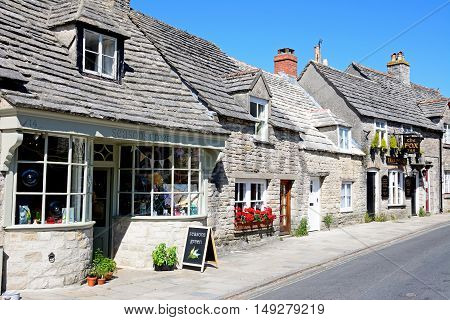 CORFE, UNITED KINGDOM - JULY 19, 2016 - The Fox Inn and shop along a village street Corfe Dorset England UK Western Europe, July 19, 2016.