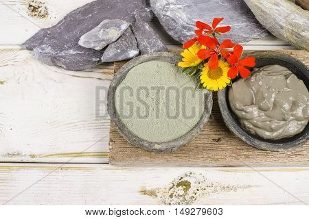 Ancient minerals - green clay powder and mud mask for spa beauty concept