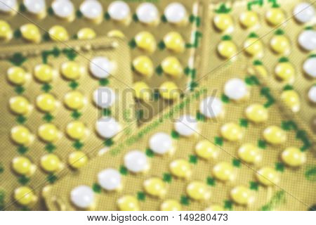 Blurred medical contraceptive pills for background. Blister of birth control pills.