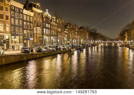 View of an Amsterdam canal by night