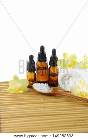 Spa setting with orchid ,towel, oil ,salt in spoon with mat texture