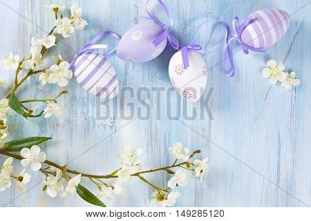 Spring flowers and colorful Easter eggs frame.