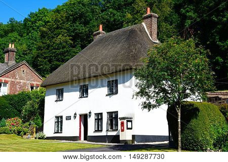 MILTON ABBAS, UNITED KINGDOM - JULY 19, 2016 - View of the thatched post office along the main village street Milton Abbas Dorset England UK Western Europe, July 19, 2016.