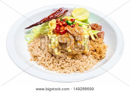 Fried rice shrimp paste with pork and fried egg isolated on white background. Fried rice with shrimp paste Thai style food.