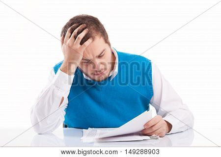 Young businessman working hard holding documents, studio shot