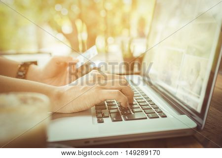 Hands Holding Plastic Credit Card And Using Laptop.