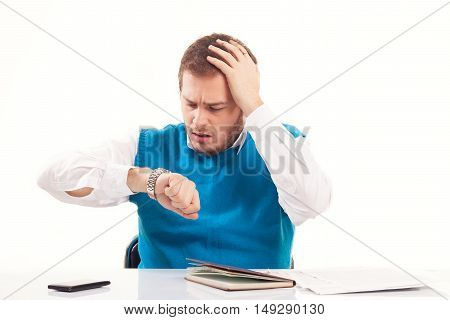 Young businessman working on a deadline, studio shot
