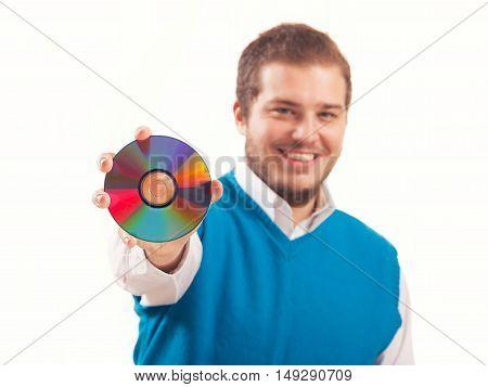 Young man holding a CD, studio shot