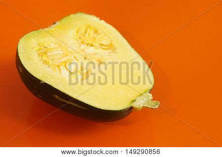 Yellow and ripe pumpkin lie on a bright background