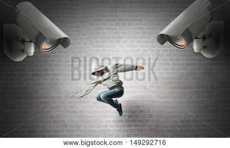 Camera keep an eye on man . Mixed media