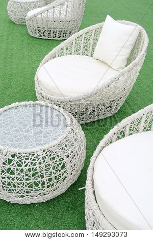 white lounge sunbeds standing on green grass