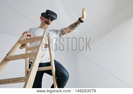 Young Man In Vr Glasses Climbing A Ladder