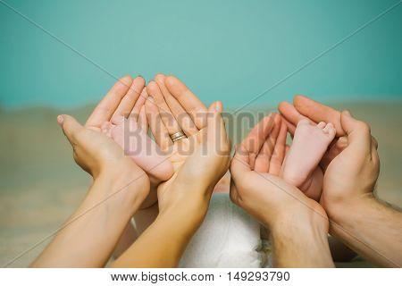 Newborn Cute Feet In Hands