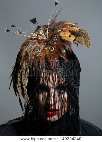Pretty Sexy Woman In Feather Hat And Veil