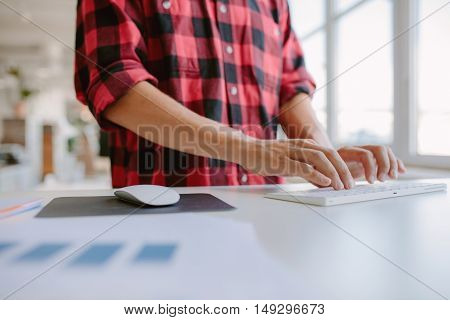 Man Hands Typing On Computer Keyboard