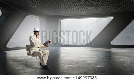 Businessman in white suit in office . Mixed media