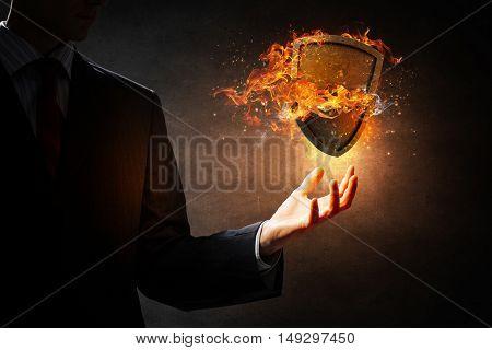Shield burning in fire . Mixed media