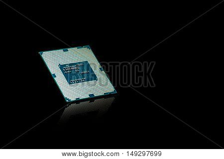 Computer processor chip CPU on black reflective background