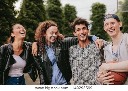 Four Young Friends Smiling Together