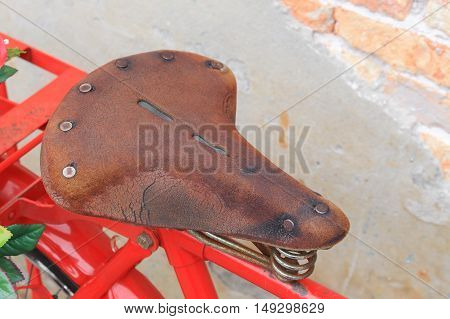 Bag Black bicycle red travel saddle Closeup, old brick wall background