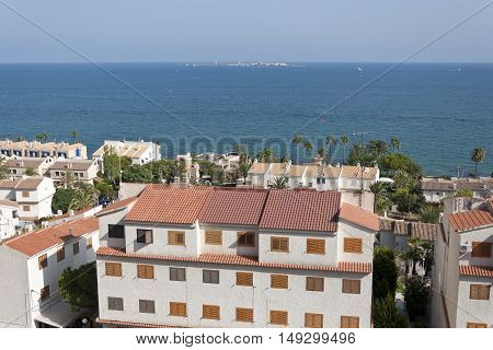 Views of Santa Pola town with Tabarca islet at the background. It is a coastal town located in the comarca of Baix Vinalopo in the Valencian Community Alicante Spain by de Mediterranean Sea.